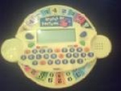 WHEEL OF FORTUNE JUNIOR VIDEO GAME (TIGER ELECTRONICS RARE YELLOW VERSION HANDHELD GAME)