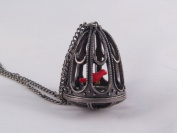 Victorian Style Bird Cage Necklace with a Red Canary