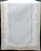 Table Runner in a Finesse Design featuring delicate white embroidered leaf detail.