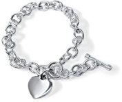 "Sterling Silver Heart Charm Toggle Bracelet 7 and 1/2"" in Length. The Heart Charm Measures 1/2"" wide by 1/2"" High And The Bracelet Is 5mm Wide"