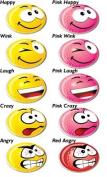 A SET OF 5 VARIOUS ASBRI YELLOW SMILEY GOLF BALL MARKERS