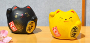 Two Maneki Neko Feng Shui Lucky cats black for protection yellow for good fortune in finance