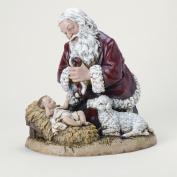 Snow Valley Kneeling Santa with Lamb Figurine