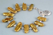 Ladies gold coloured fresh water pearl bracelet with crystal