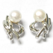 Dainty sterling silver and white pearl stud earrings, freshwater cultured pearls, button shape , genuine sterling silver, marked 925, attractively packaged.