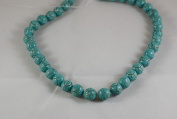 Howlite turquoise carved round beads, 10mm, sold per 16-inch strand.