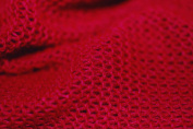 Knit & Purl Jersey Stretch Fabric, a light weight, Open Knit Semi-Translucent and airy fabric cloth, stable and durable. Resilient With elastane properties, extremely soft handle. 150cms wide. Beautiful selection of 7 colour choices. Red, Grey, Charcoa ..