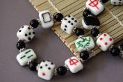 Casino Theme Dice and Black Mahjong Card Design Handmade Lampwork Glass Stretch Bracelet