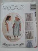 McCall's Sewing Pattern 8652 Girls' Dress, Pinafore, Hankie and Headband, Size CL
