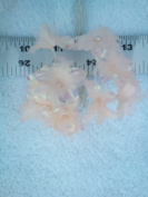 Irridescent-peach star flower pick. Each flower is the size of a nickel and each flower is on a 10cm white wire stem. The bottom layer of each flower is an irridescent peach cloth, covered by a layer of the lightest peach organza, with a light peach pe ..