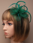 Green net and feather hair fascinator on a slim alice band ,suitable for weddings, races, prom