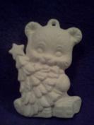 Teddy Bear with a christmas tree ornament