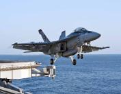 F-18 Hornet taking off from an aircraft carrier