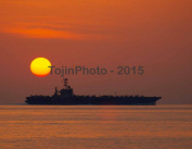 USS John C. Stennis (CVN 74) operates in the Arabian Sea during sunset