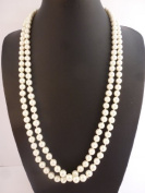 Long rope necklace simulated pearls look and feel of genuine