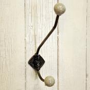 Classic black wrought iron single coat hook with crackle glaze ceramic finish