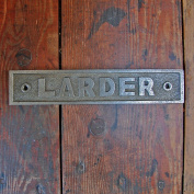 Old fashioned traditional cast metal plate larder door sign.