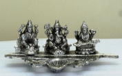 Lightahead® Lord Ganesh,Goddess Lakshmi & Saraswati a unique diya tea light candle stand in white metal statue of Hindu Gods on a feather made in India Great Diwali gift
