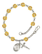Silver Plate Rosary Bracelet features 6mm Topaz Fire Polished beads. The Crucifix measures 5/8 x 1/4. The charm features a St. Margaret Mary Alacoque medal.
