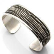 Heavy Stamped Bracelet by Maloney