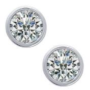 0.98 ct Lady's Bezel Set Round Cut Diamond Stud Earrings In 18 Karat White Gold Screw Back