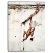 "Designart PT6969-80cm - 100cm Baby Orangutan Hanging From Pipe Street Art"" Canvas Print, Brown, 80cm x 100cm"