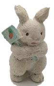 RABBIT FIGURINE HOLDING A CARROT SIGN