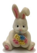 WHITE BUNNY RABBIT HOLDING A BOUQUET OF FLOWERS