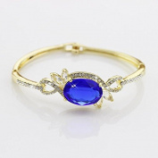 Women's Gold Bangle with Sparkly Blue Crystal Gem and Tiny Rhinestones Lining - Statement Accessory for Ladies - Clasp Clip Lock - For Formal Occasions or Casual Events