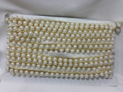 Inhika 9mtr border trim,white pearl string on white fabric with golden linning