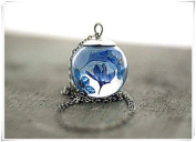 Sterling Silver Floating blue flowers. Cornflowers and forget me nots in resin in glass orb.