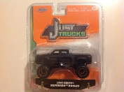 Jada 1:64 Just Trucks 1999 Chevy Silverado Dooley Black #035 by Jada Toys