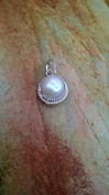 NATURAL PEARL PENDENT, MOTI LOCKET,FITED IN SILVER energised  .
