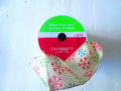 6.4cm . x 7.6mBeige basketweave wired ribbon with multi-colour snowflakes on it