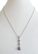 Pearl Inn AAA 5-6mm 20Inches 51cm Freshwater Cultured Pearl (Grey black) Pendent with silver plated chain combination of zircon and two sets of Matching Earring Set and pearl bracelet.