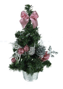 Small Christmas Tree With Ornaments Pink Bows And Silver Decorations And Base