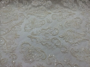 Ivory French Design With Hand Beaded Pearls and Sequins On A Mesh Lace.wedding.