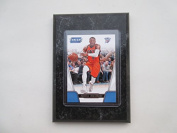 Russell Westbrook Oklahoma City Thunder Prestige Threads NBA 2016-17 player card mounted on a 10cm x 15cm black marble plaque