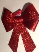 30cm x 38cm . red glitter indoor/outdoor bow MSRP 9.99