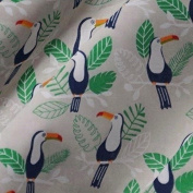 Grey Polycotton Fabric with Blue Toucans and Green and White Leaves