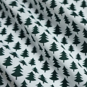White Polycotton Fabric with Bottle Green Christmas Trees